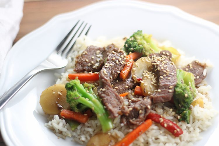 Instant Pot Beef and Veggies over Rice (homemade Chinese food) on a white plate with fork